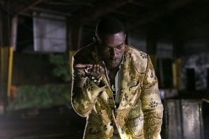 Michael James Shaw as Papa Midnite
